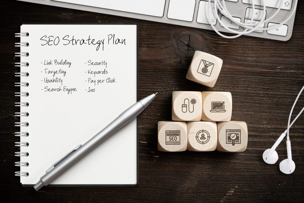 5 SEO trends, SEO strategy with components for successful marketing as icons on cubes on wooden background