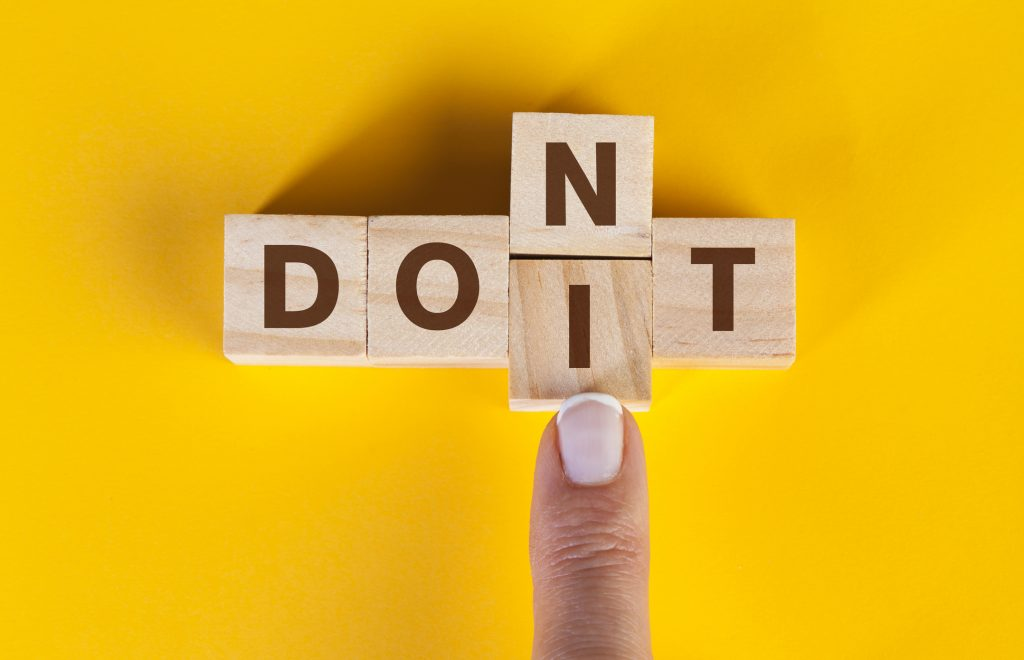 "Do's and dont's of repurposing content - Finger pushing cubes, changing the word ""don't"" to ""do it"""